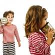 Two kids talking on a tin phone - Stock Photo