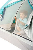 Young boy in a tent — Stock fotografie