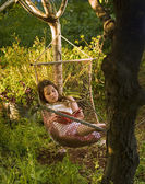 Girl in hammock dream — Stock Photo