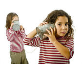 Two girls talking on a tin phone — Stock Photo
