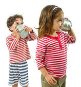 Two kids talking on a tin phone — Stock Photo