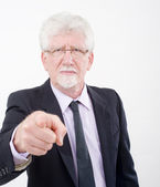 Senior businessman pointing — Stok fotoğraf