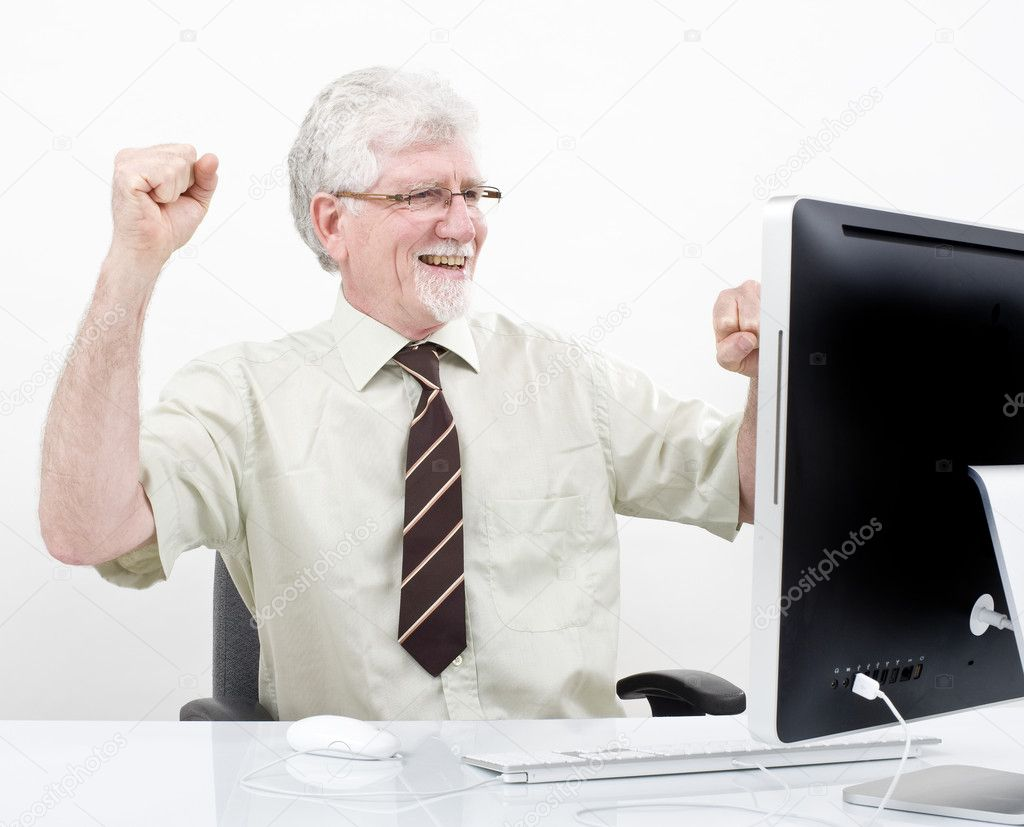 Senior businessman winning in front of computer over white — Stock Photo #2238098