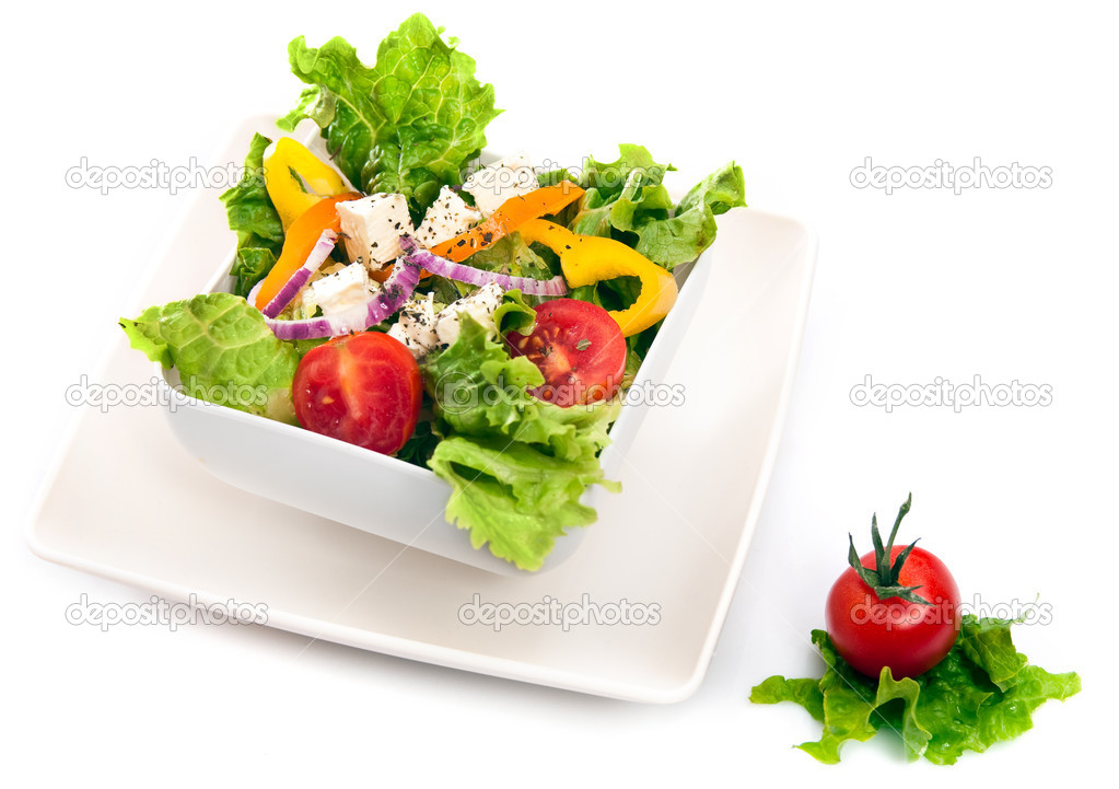Greek salad isolated on white background — Stock Photo #1860501