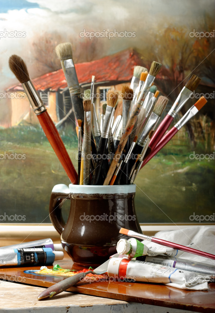 Art brushes well used in a jar on studio — Stock Photo #2045982