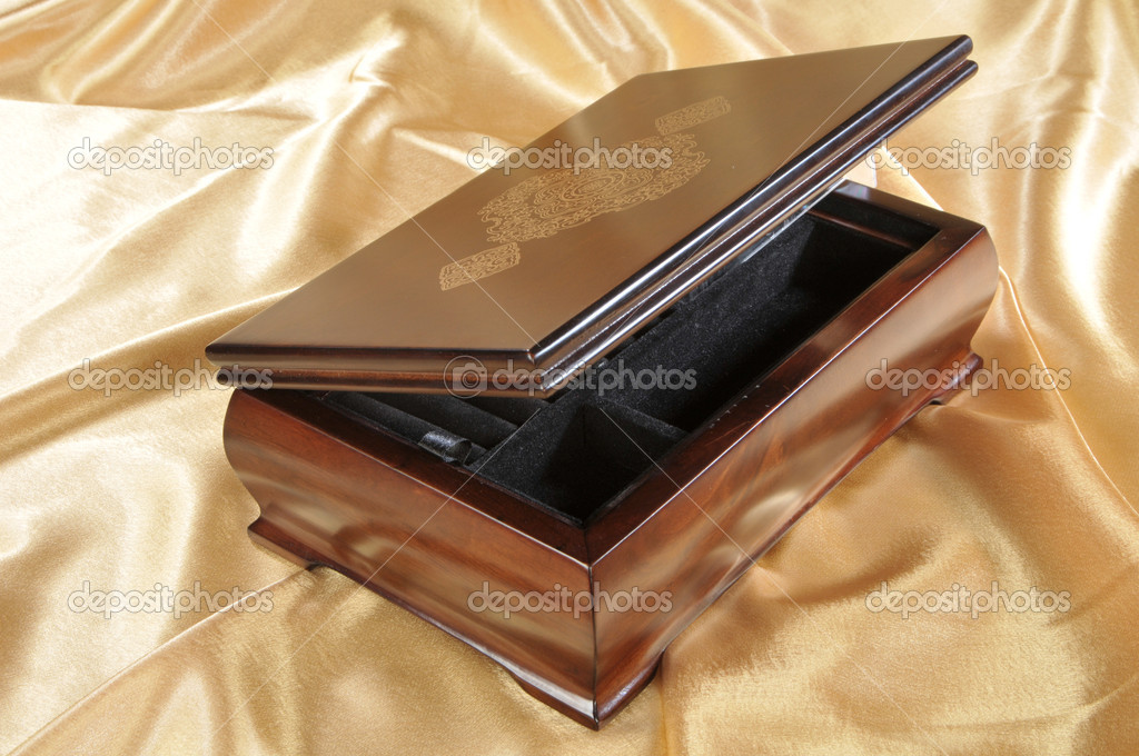 Close-up of wooden box for keeping valuables on golden background  — Stock Photo #1453399