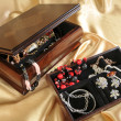 Wooden box with jewelry - Stock Photo