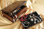 Wooden box with jewelry — Stock Photo