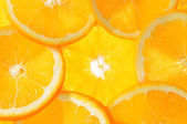 Fresh orange fruits background — Stock Photo