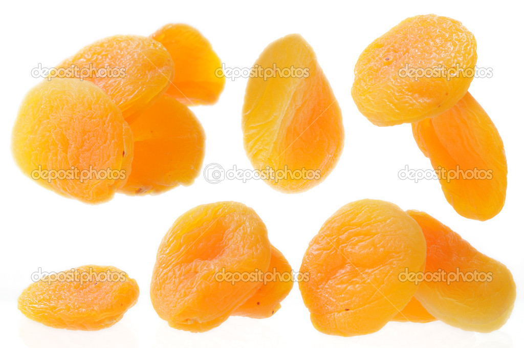 A close up of few dried apricots isolated on white — Stock Photo #1570659