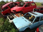 Car cementary with many broken cars — Stock Photo