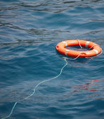 Lifebuoy on the water — Stock Photo