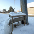 Stock Photo: Frozen old water pump in Czech village