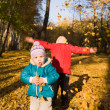 Children throw autumn leaves — Stock Photo