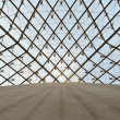Glass dome of a pyramid in the Louvre - Stock Photo