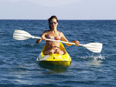Woman on kayak — Stock Photo