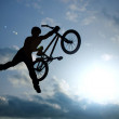 Silhouette of boy with bicycle — Stock Photo