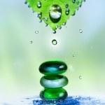 Spa stones in water splash — Stock Photo