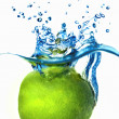 Fresh lime dropped into water — Stock Photo