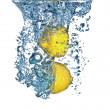 Royalty-Free Stock Photo: Fresh lemon dropped into water
