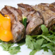Shashlik with potherbs on the plate - Stock Photo