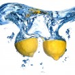 Fresh lemon dropped into water — Stock Photo #1366958