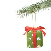Christmas gift on fir tree — Stok fotoğraf