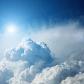 Dramatic storm clouds with sun — Stock Photo