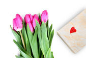 Close-up pink tulips with gift — Stock Photo