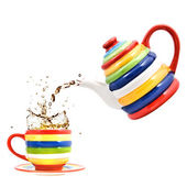 Color teapot with cup and splash of tea — Stock Photo