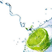 Fresh water drops on lime — Stock Photo