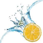 Fresh lemon dropped into water — Stock Photo