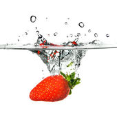 Strawberry dropped into water — Stock Photo