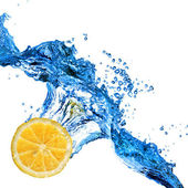 Orange dropped in to water — Stock Photo