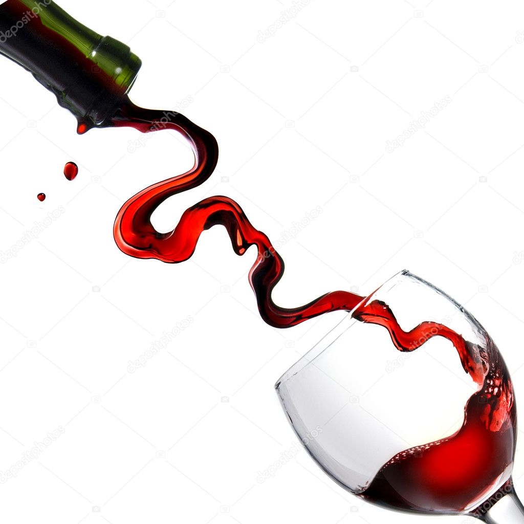 Pouring red wine in glass goblet isolated on white  Stock Photo #1363748