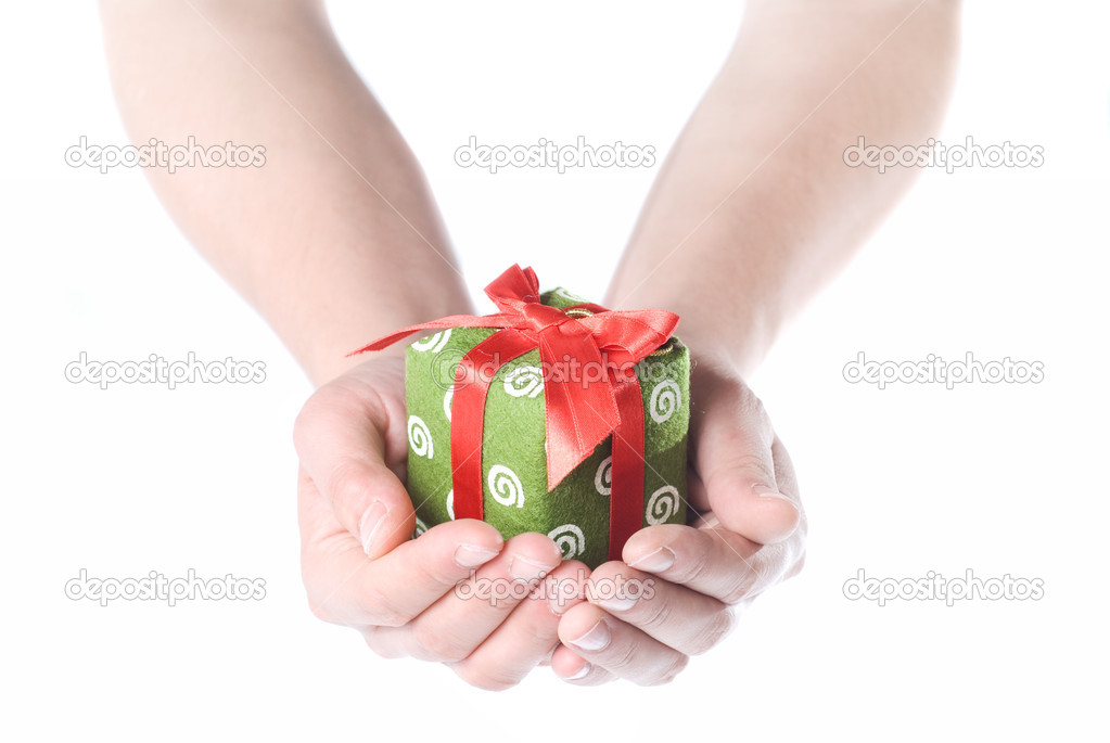 Hands holding gift isolated on white — Lizenzfreies Foto #1366734