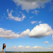 Couple against blue sky — Stock Photo