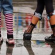 Emo shoes standing under the rain - Stok fotoğraf