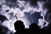 Silhouette of church with crosses — Stock Photo