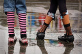 Emo shoes standing under the rain — Stock Photo