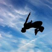 Silhouette of jumping man — Stock Photo