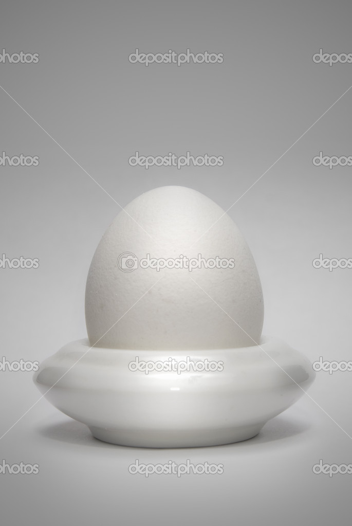 Egg in the eggcup vertical — Stock Photo #1382996