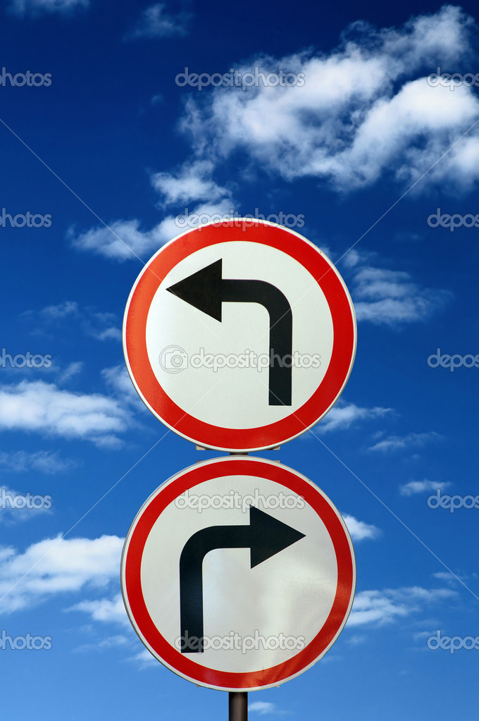 Two opposite road signs against blue sky and clouds  Stock Photo #1390007