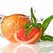 Water splash on grapefruit with mint — Stock Photo #2622391