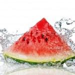 Watermelon and water splash — Stock Photo