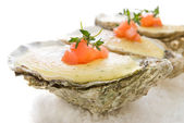 Oysters with sauce — Stock Photo