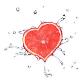 Heart from grapefruit with water drops — Stock Photo