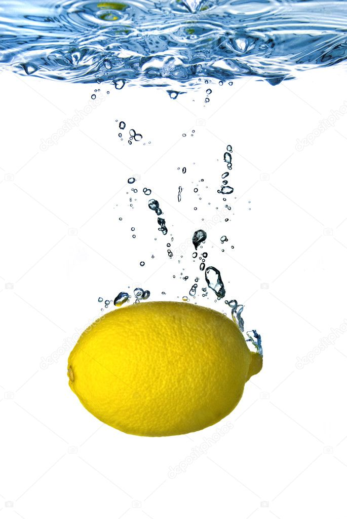 Fresh lemon dropped into water with bubbles isolated on white — Stock Photo #2621885