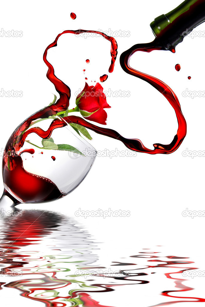Heart from pouring red wine in goblet isolated on white  Stock Photo #2622279