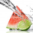 Watermelon, lime and water splash — Stock fotografie